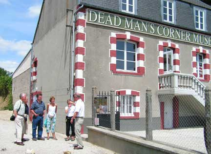 Near Saint Come du Mont is the Dead Man's Corner Museum. Mike is explaining to the group how this famous corner got its name. Here again, during the movie The Longest Day, this building, and it is still the original, was used in the film. It stood empty for a long time prior to being reopened as a musee. This was one of the nicest ones we visited.
