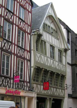 "The old part of the city of Rouen is filled with this old architecture in the Norman style. Look closely and you will see the ""Golden Arches"" on the red flag. Yes, this is a McDonalds."