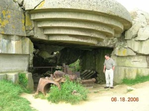 I was observing the damage to the gun from a charge that was placed inside the barrel and on the emplacement.