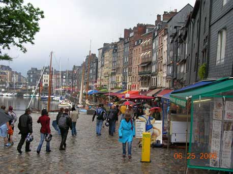 A rainy day in Honfleur. Home of pioneer Impressionist Eugene Boudin. Renoir, Pissaro and Cezanne also came here to paint.