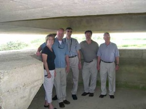 Some of us inside a German range-finding post at the Batterie de Longues Sur Mer. In the close-up on the right you see Pam & Mike, Gary, myself and Don.