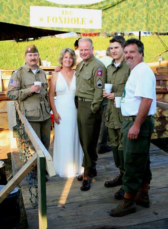 Friends in uniform ready to toast the married couple.