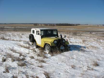 A cold lonely jeep sitting in MN. Last licensed in 97. I don't think it has moved from there since then. Pretty tough shape.