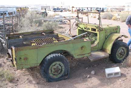 Another wounded Dodge waiting its fate. A good parts truck, too much missing for a restoration.