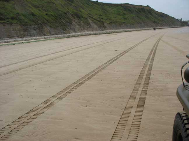 I know what made these tracks, do you? Click on the album link to find out. This is on Gold beach headed towards Arromanches. How would you like to have climbed these cliffs under fire? Scary stuff.