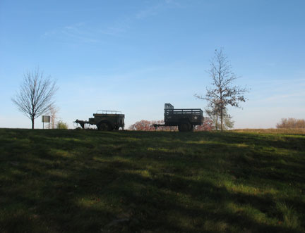 Lonely trailers sitting on the hill. M101 in nice shape and an M332 ammo trailer.