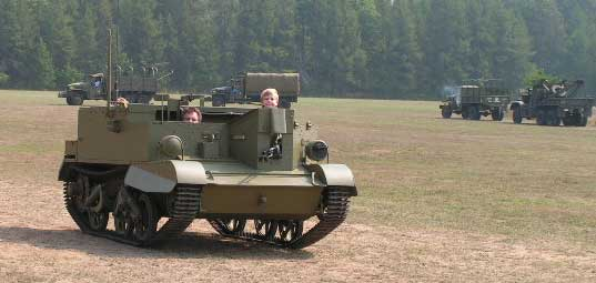 My newly restored Bren Gun Carrier. Myself driving, with sons, Braden in front and Ranon in back,(top of head only).