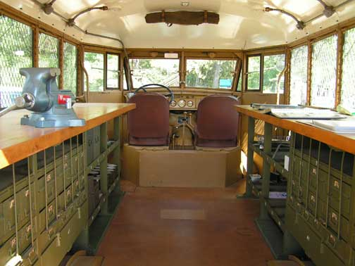 This is the inside of the GMC Small Arms bus. Nicely restored and outfitted.