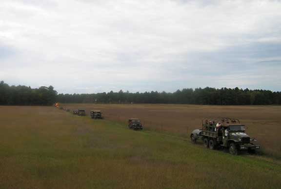 The start of the convoy. The airport is way off behind the far tree line. We had a combo on-off road trip this year. The WWII warbirds made mock straffing runs and escorted us thru the entire 38-mile trip.