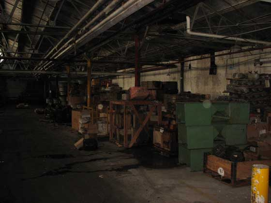 These two pictures are the left and right views of the next stop. Typical surplus warehouse, leaky ceilings and lots of disarray. Some good parts were found here though. NOS Jeep flywheel ring gears, oil floats and some WWII stuff too.