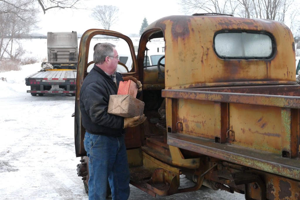 Removing parts stored in the cab.